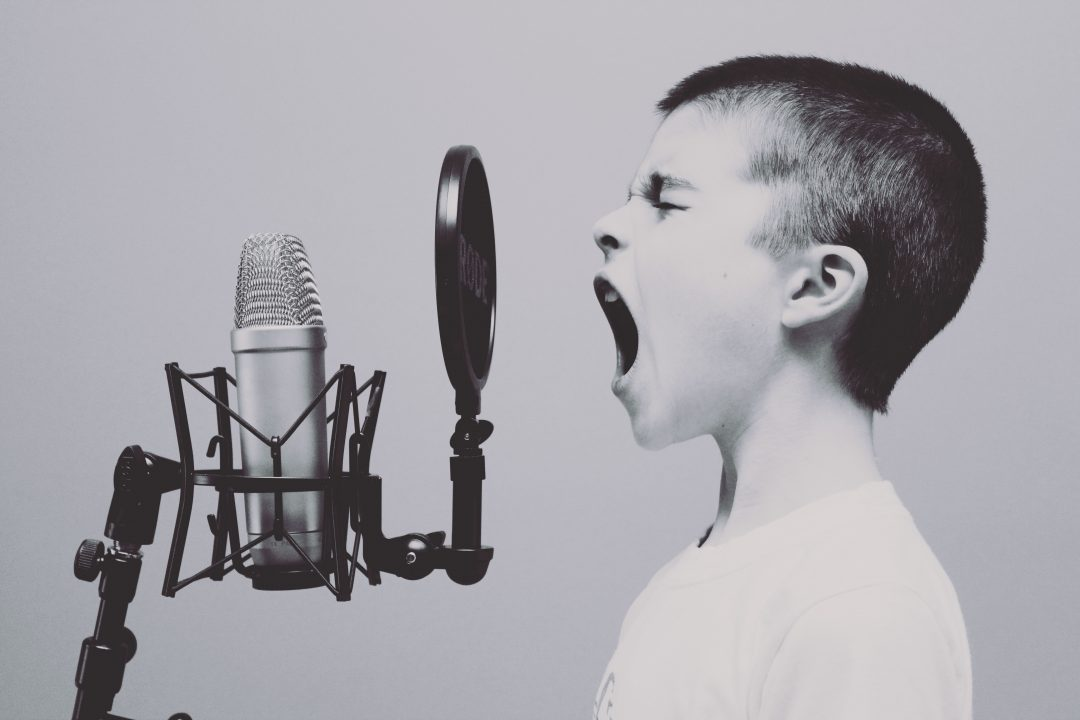 boy shouting into a microphone