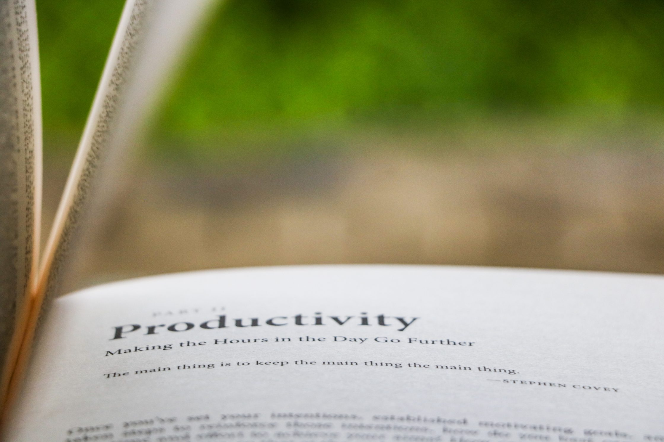 book open to the word productivity